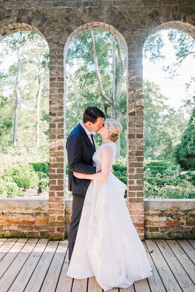 Custom Preset on Wedding Portrait of Couple under Brick Arches