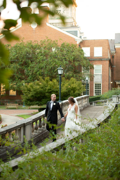 Unedited Portrait of Bride and Groom Walking on Stairs