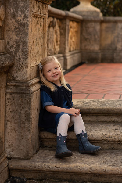 Unedited Photo of Little Girl Sitting on Steps for Portrait