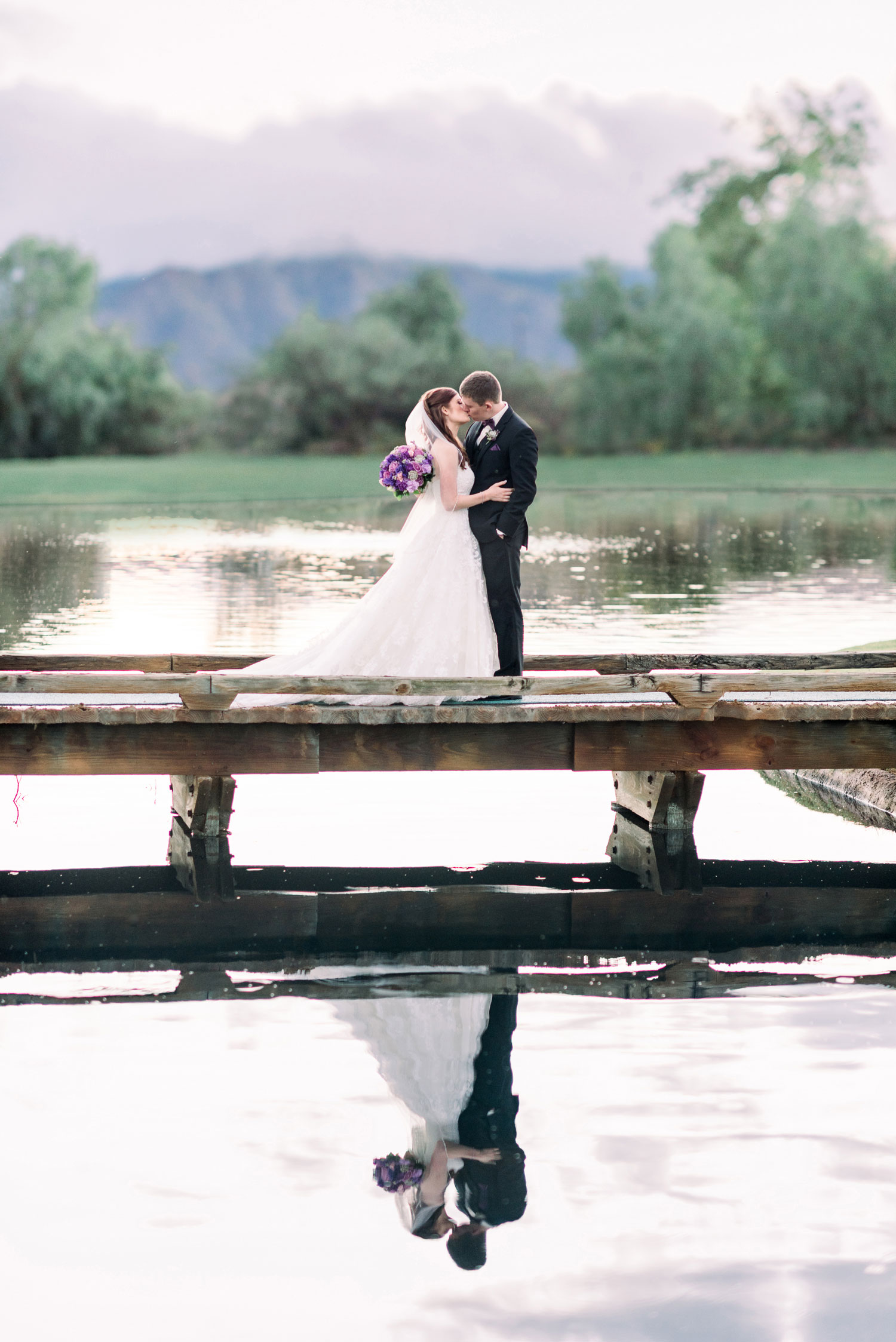 Custom Retouched Photo with Background Swap on Wedding Portrait of Couple on Bridge