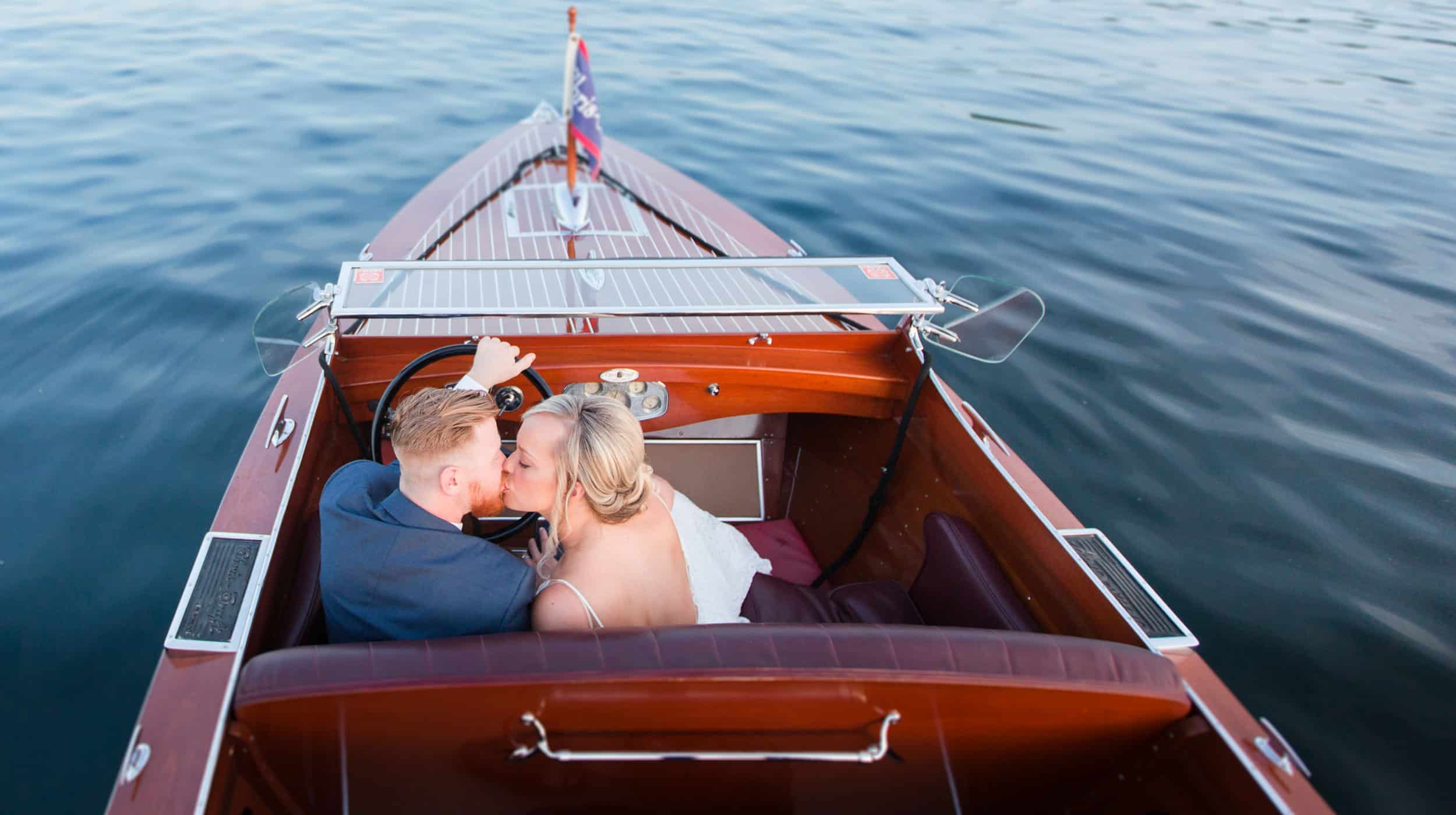 Wedding Portrait in Boat of Husband and Wife Edited by Photographer's Edit. Outsourcing editing has taken the weight off for post production.